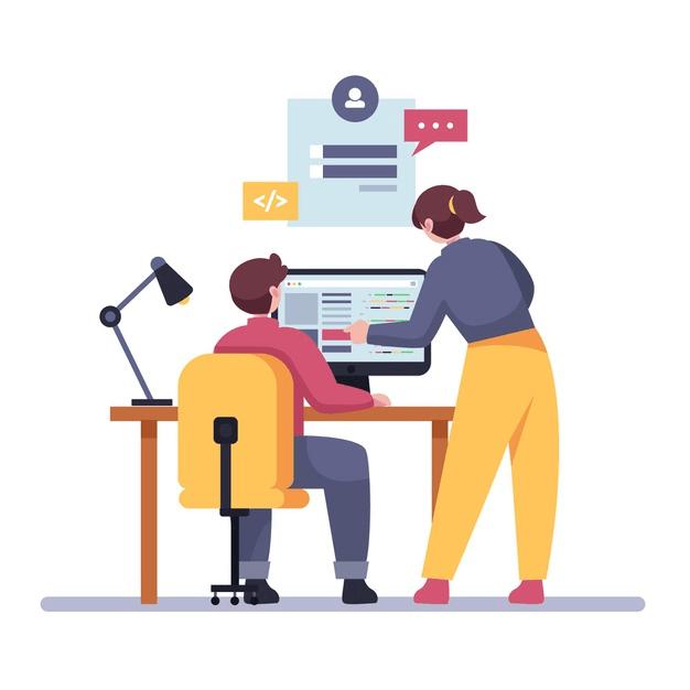 2 personnes sont à un bureau, devant un ordinateur. Elles discutent.